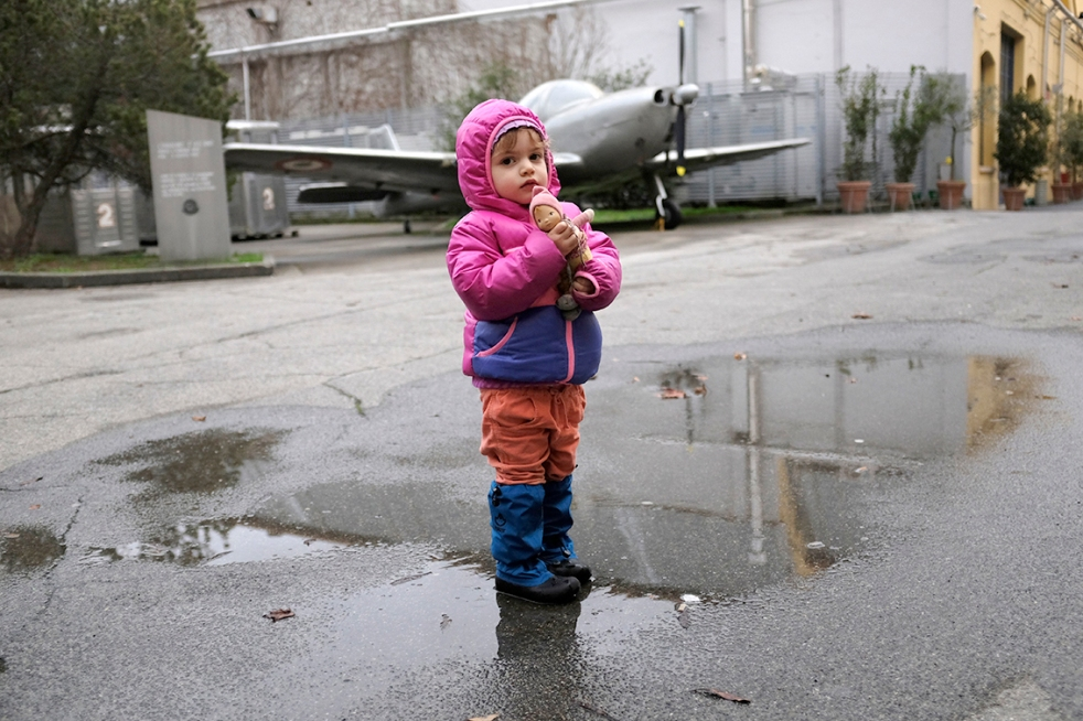 Vespa airplane Piaggio Museum Pontedera Child in Puddle Rain The North Face