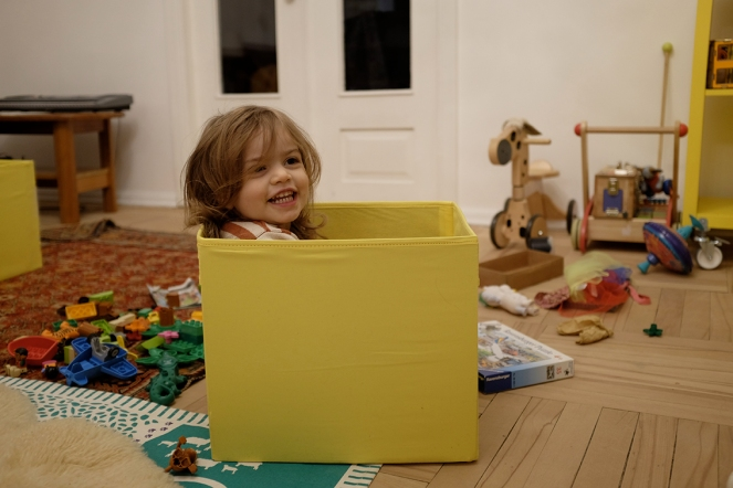 """I call this game fun-in-a-box."" - Dr. Seuss from The Cat in the Hat. Child in a box. Kinesthetic Sensory Activity"
