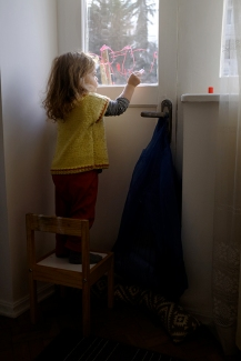 Child Drawing with Washable Window Crayons
