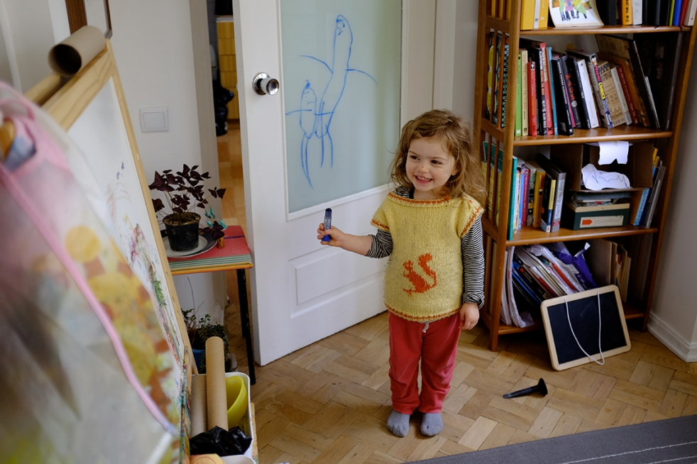 Child Drawing on Glass with Washable Crayons