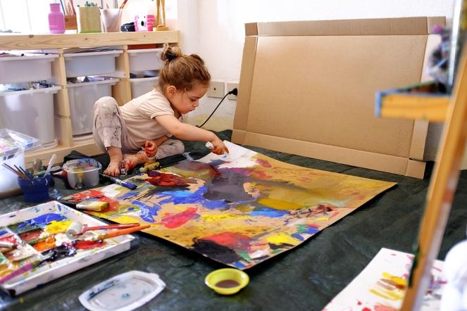 Painting on Cardboard in Artist Studio on the floor
