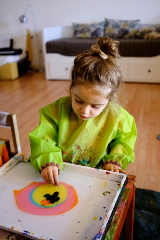 Child using Marbling Ink Kit for Japanese Suminagashi and Chopstick wearing IKEA MÅLA Art Smock