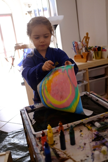 Child doing Suminagashi with Japanese Marbling Inks and Fabriano Paper