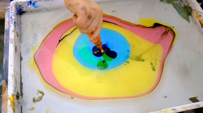 Child using Marbling Ink Kit for Japanese Suminagashi