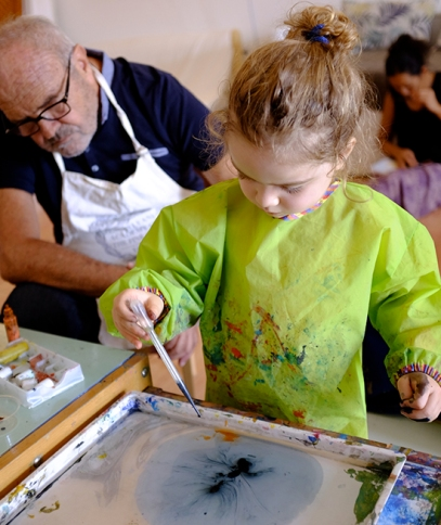 Child using Marbling Ink Kit for Japanese Suminagashi and Dropper wearing IKEA MÅLA Art Smock