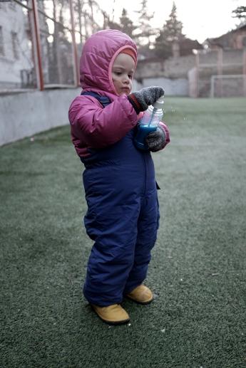 child rain clothes spraybottle