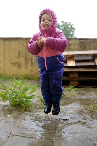 Child splashing in a puddle The North Face