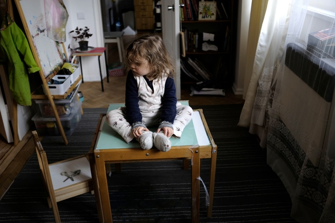 child sitting on table feet together IKEA easel table chairs