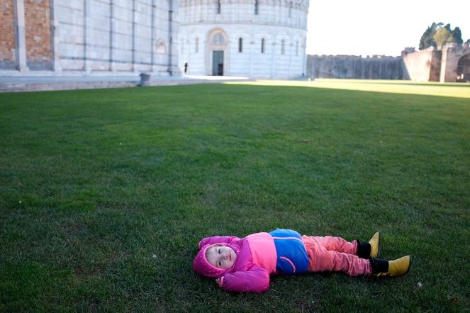 Duomo di Pisa Church Basilica Cathedral child lying on grass