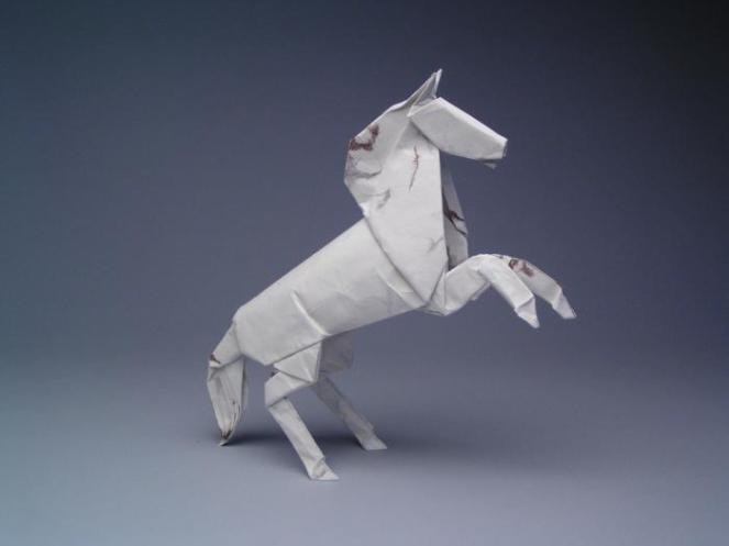 "Created: 2002 Medium: One uncut square of Origamido paper Dimensions: 12"" Artists: Robert J. Lang Composition: Alamo Stallion, Opus 384"