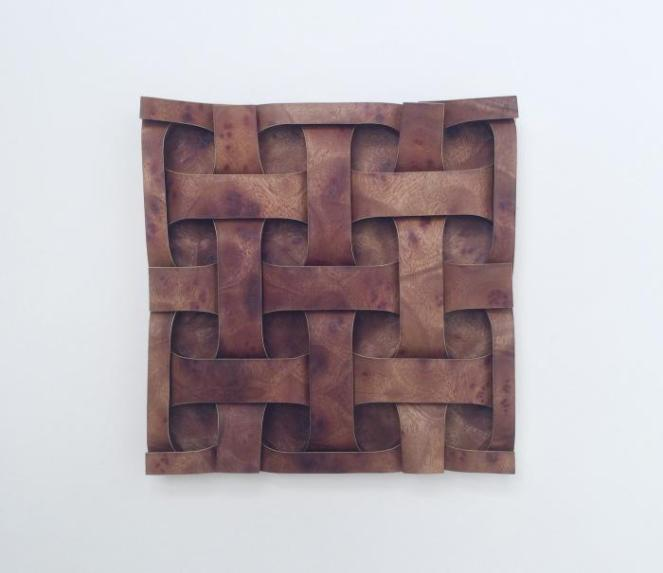 "Created: 2015 Medium: One uncut square of camphor wood veneer laminate Dimensions: 8"" x 8"" x 1"" Artists: Robert J. Lang Composition: Curved Square Weave, Opus 665"